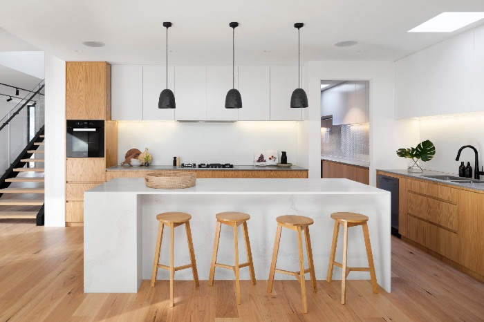 white kitchen and black down lights